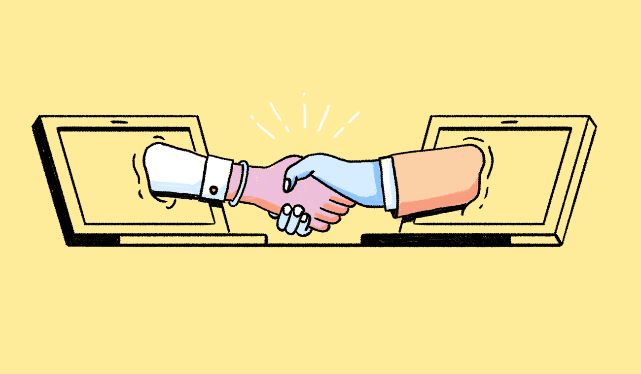 A handshake, with the respective arms reaching out from two different laptop monitors.