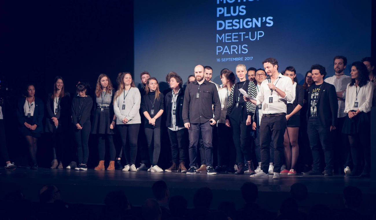 Kook Ewo and his team on stage at Motion Plus Design's 2017 Paris meet-up.