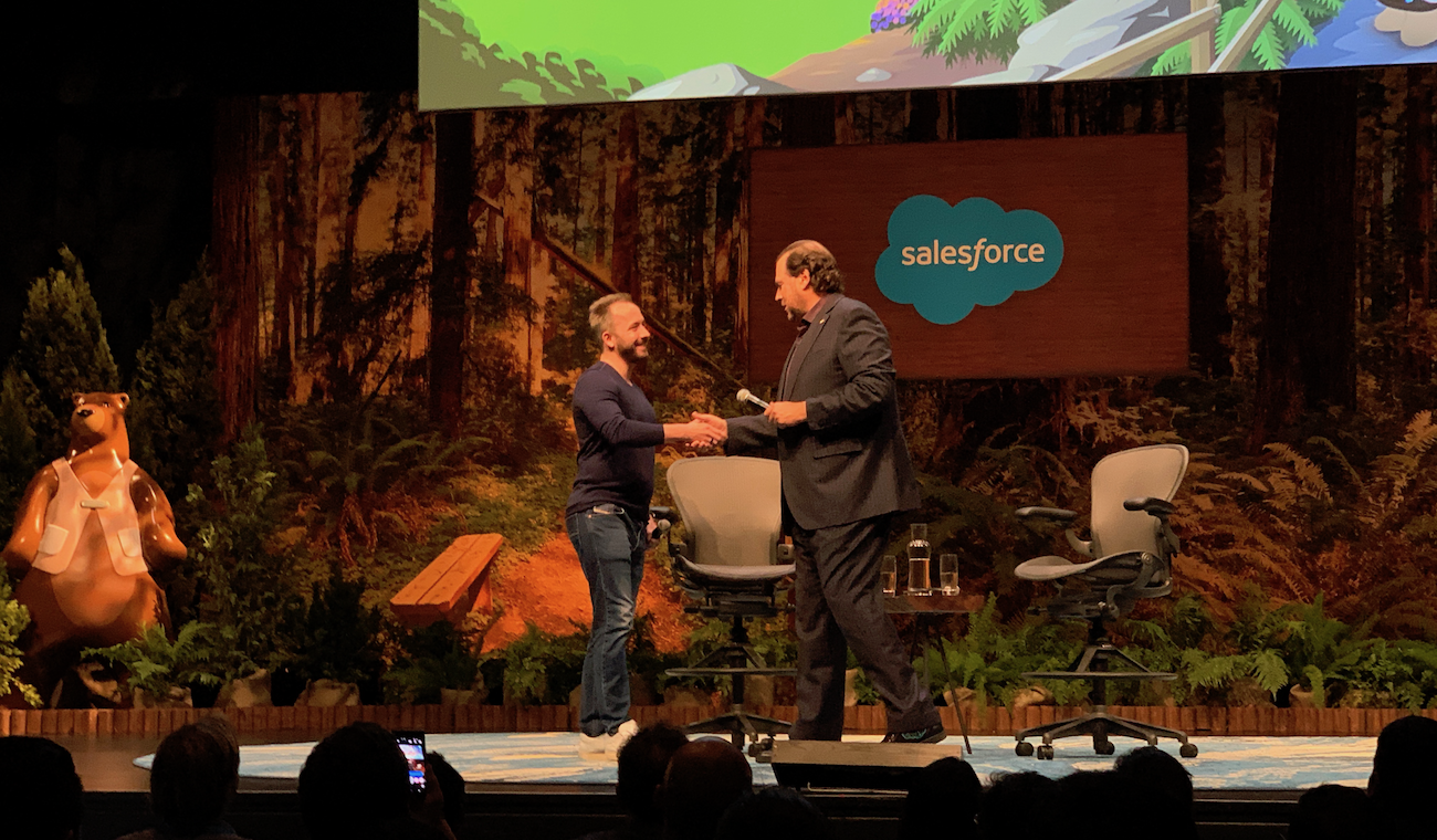 Drew Houston and Marc Benioff shake hands at Dreamforce 2018