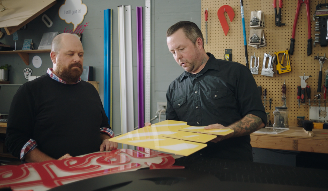 Photo of Martin and Bobby at Martin Sign Company