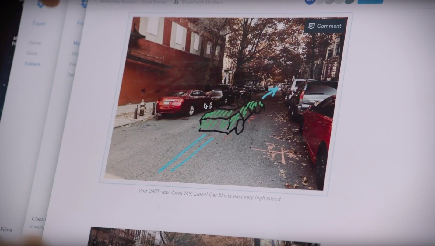 Screenshot of photo of street with drawing of car's path overlaid, shown in Dropbox Paper