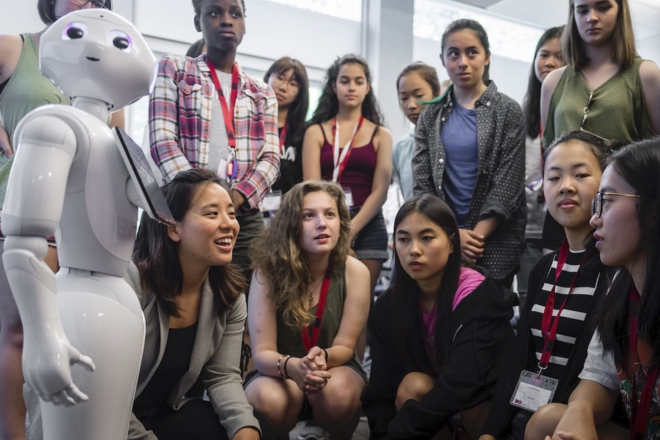 Photo of A.I. roboticist Angelica Lim and students from AI4ALL