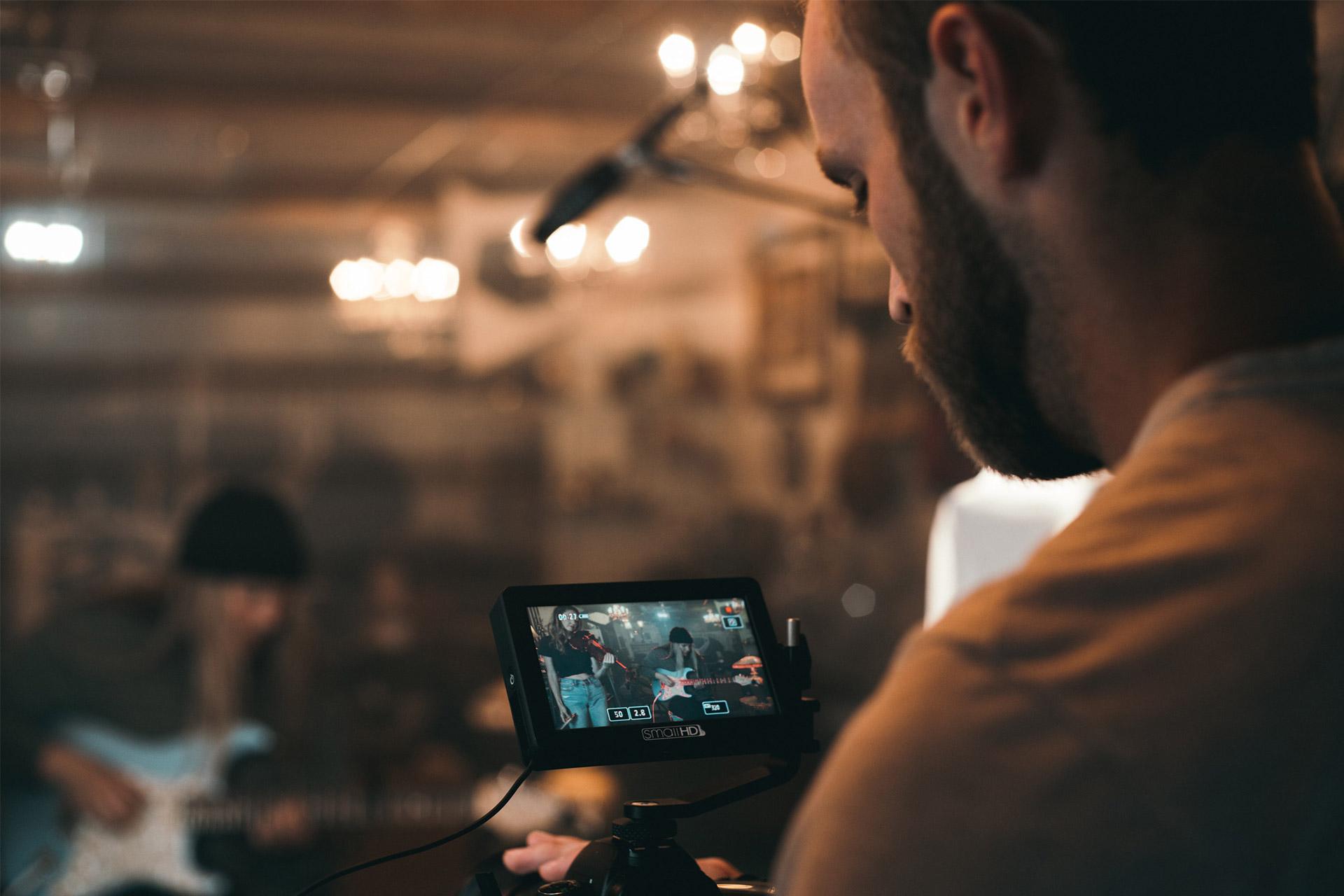 A person recording a music video which will require compression