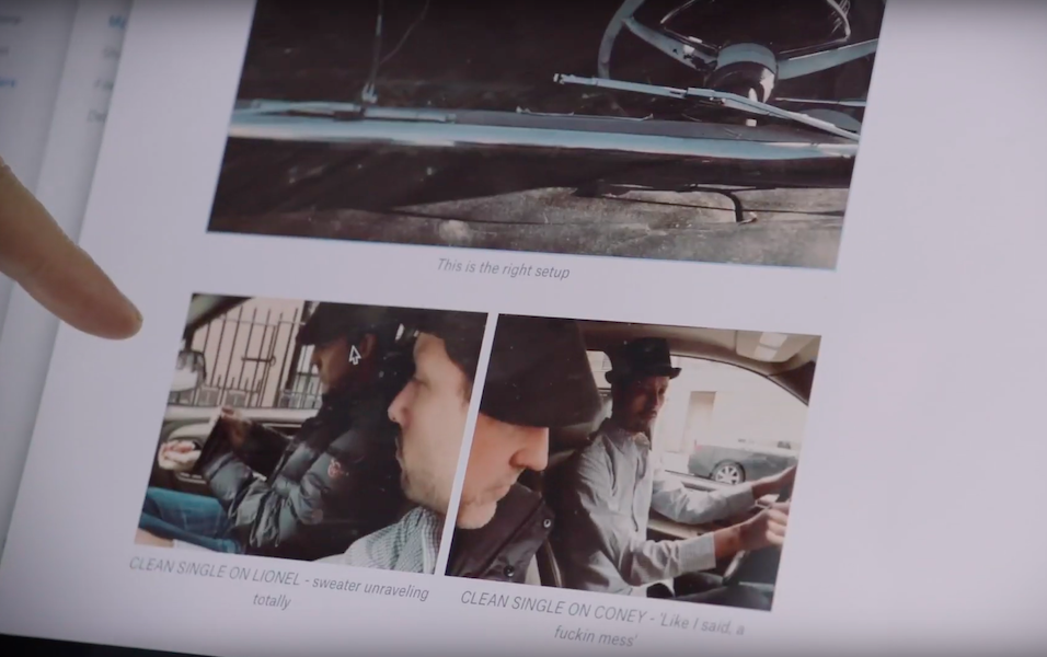 Finger pointing at screen with images of a film storyboard in Dropbox Paper