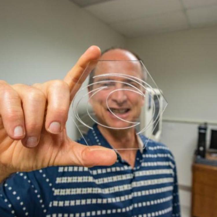 Man holding Oceanit logo in office