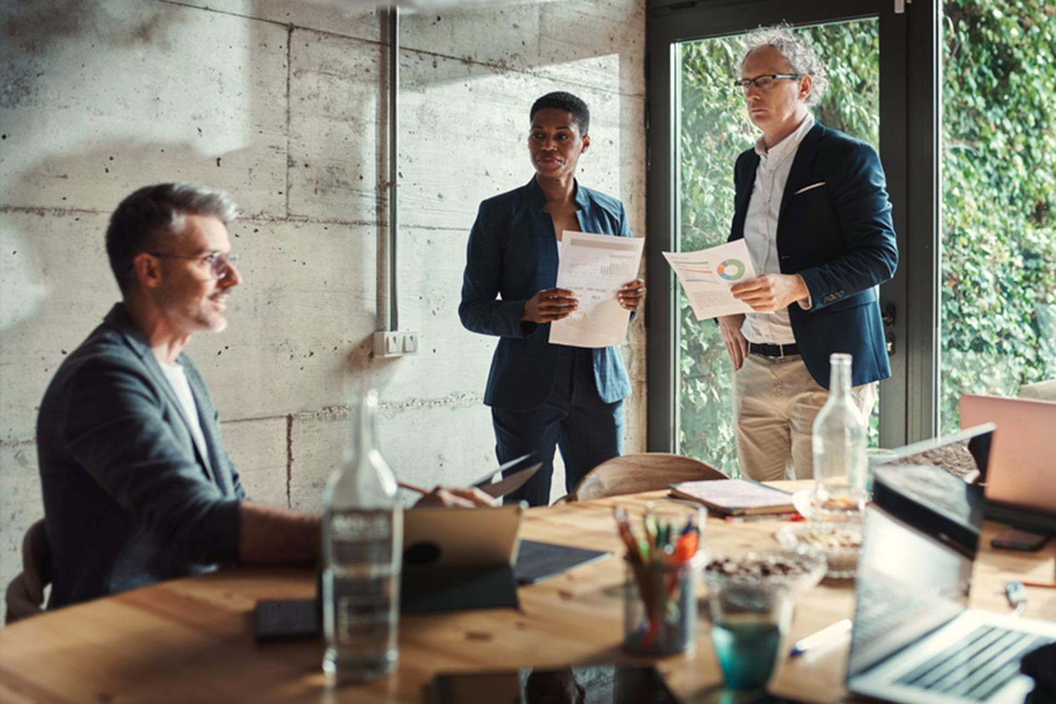 Business leaders overcoming productivity challenges in a meeting