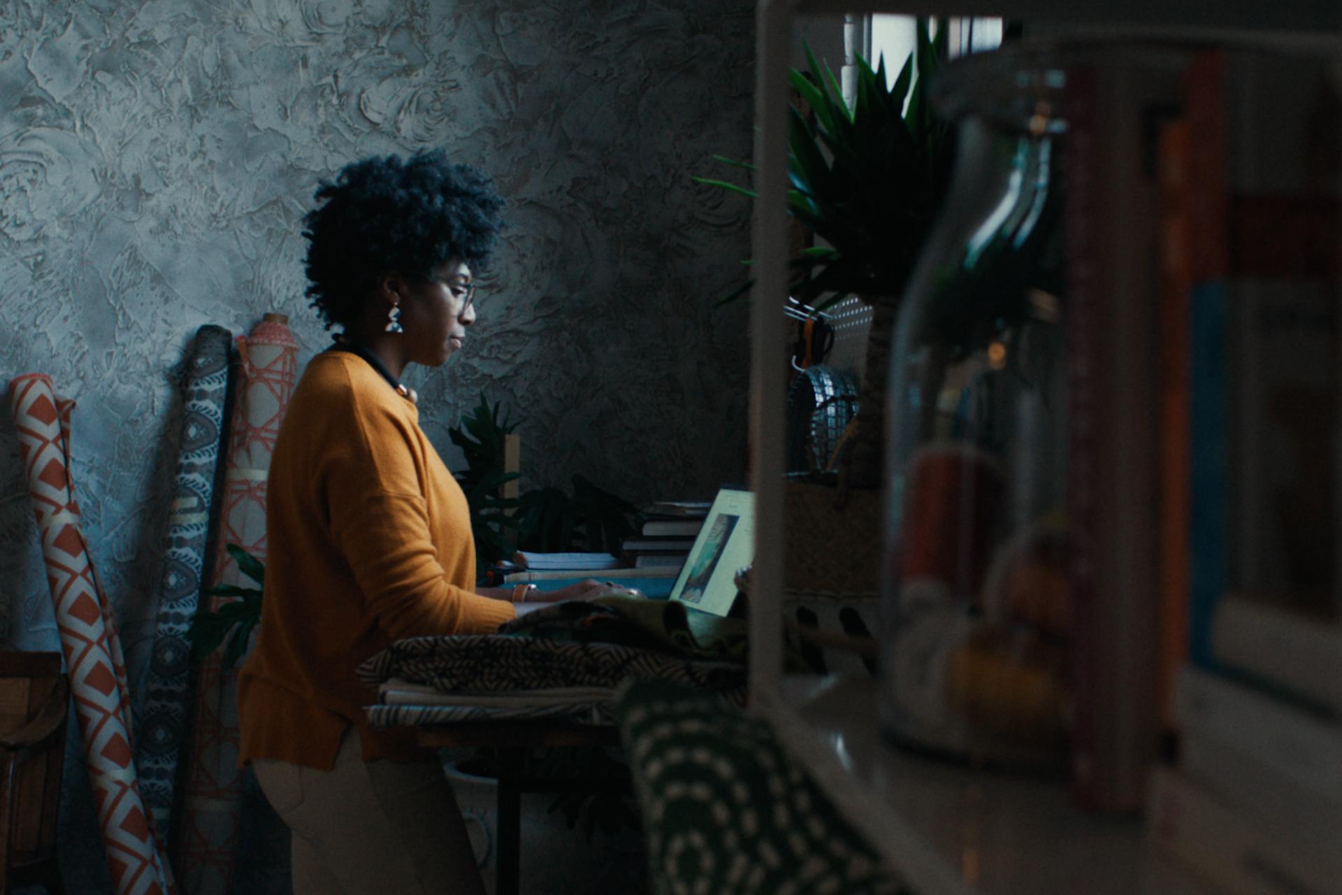 Furniture designer Nicole Crowder at work on her laptop