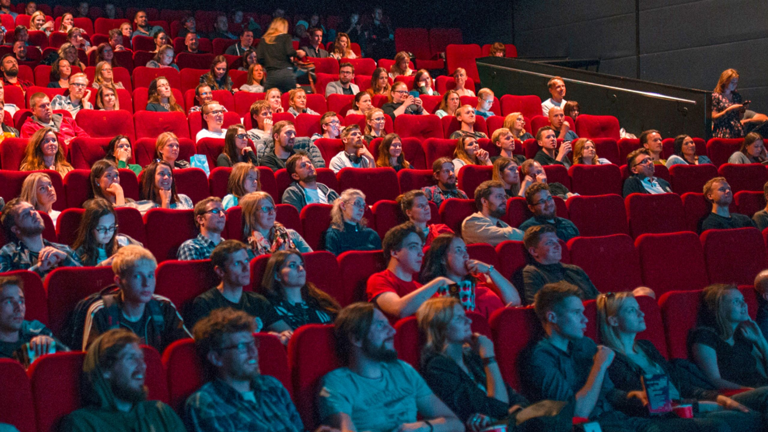People sitting in a crowded movie theater