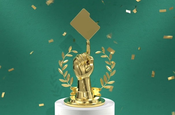 Golden trophy in the shape of a hand pointing to a file