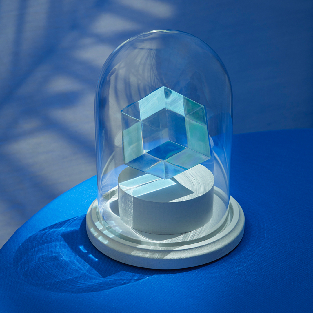 Translucent cube inside glass case