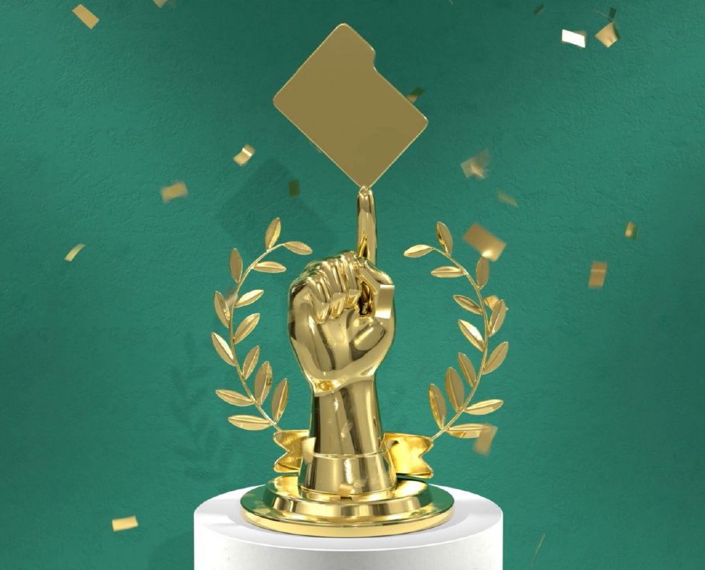 Golden trophy of a clenched fist with an outstretched index finger balancing a folder